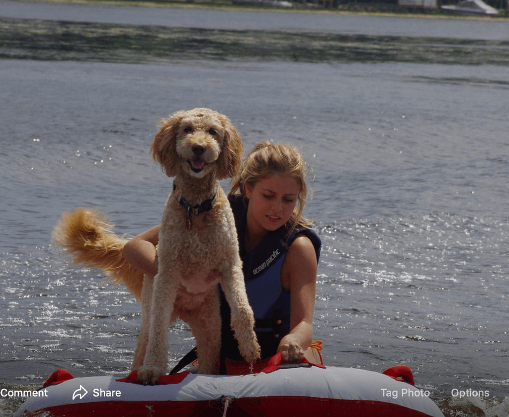 This is our former dog wet dog Sammy tubing with our daughter Mackenzie