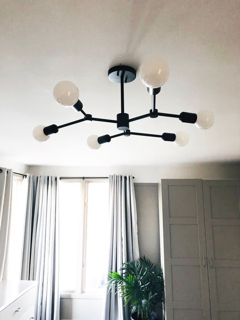 We are loving this dramatic fixture above our bed.  It is such a feature in the room