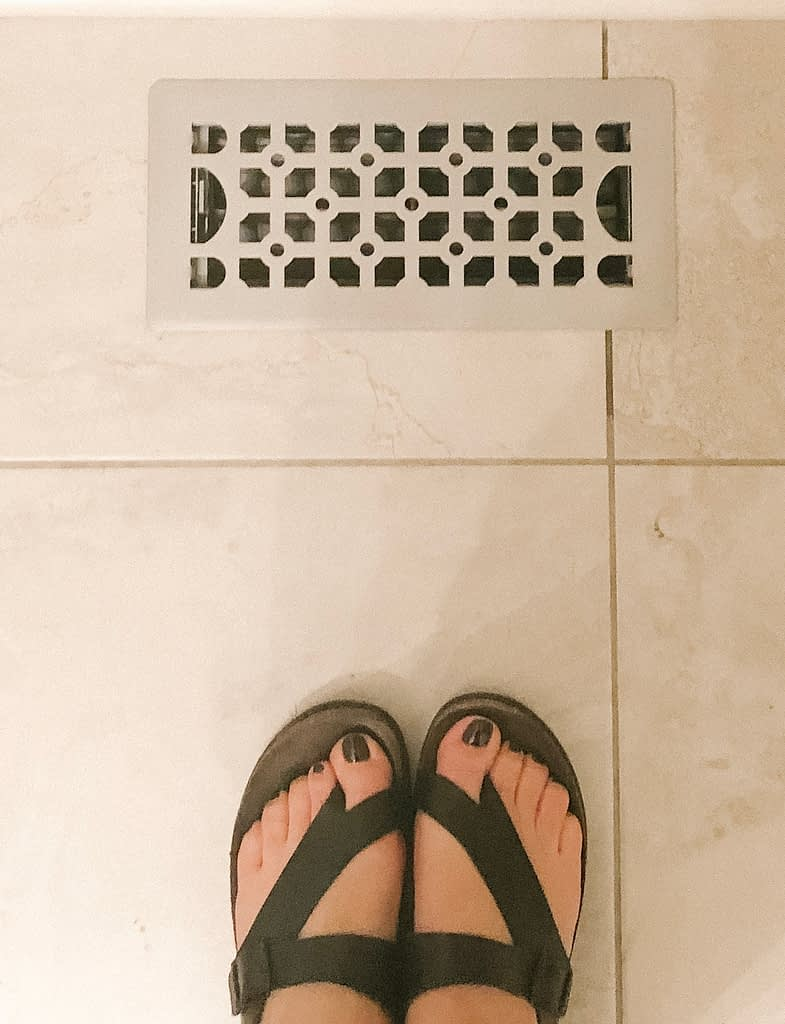 Don't mind my feet, but the vent cover looks so much better without rust, painted with Rug-Oleum paint.