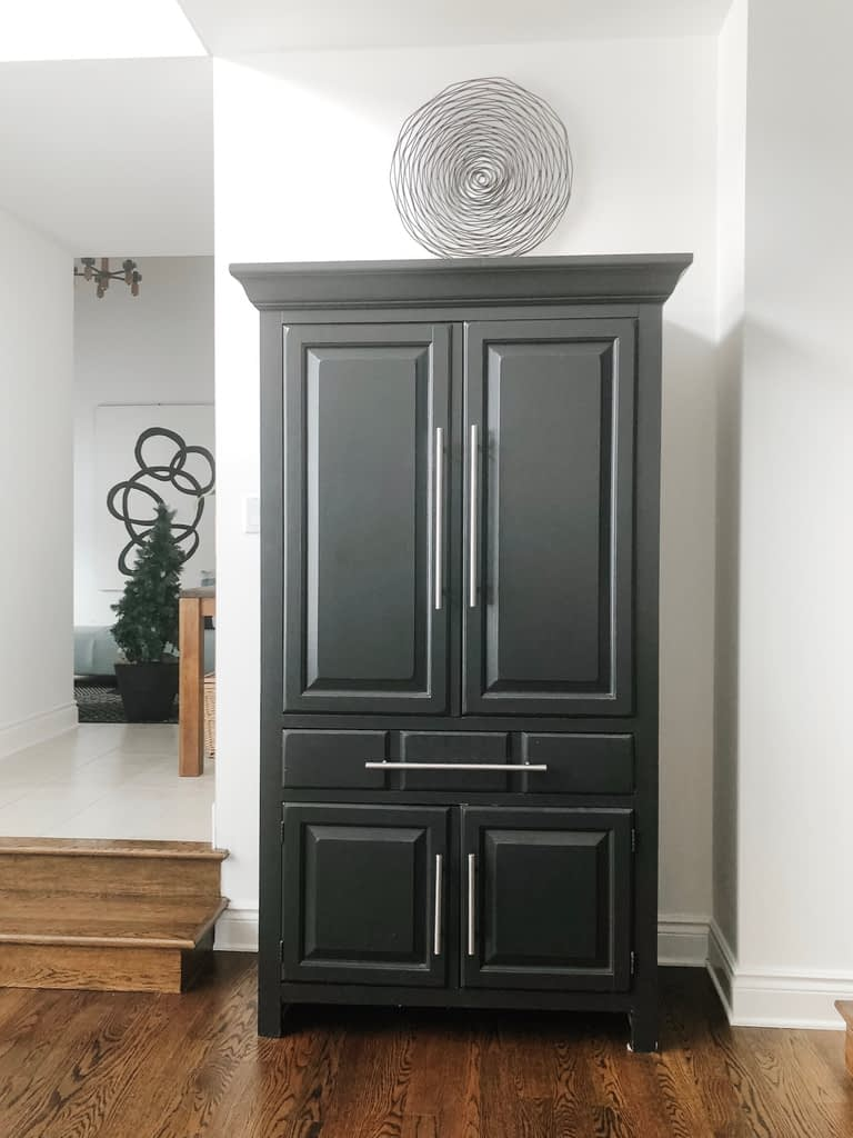 I painted this traditional cabinet that holds our china black.  It is adjacent to our wood dining table with black legs.