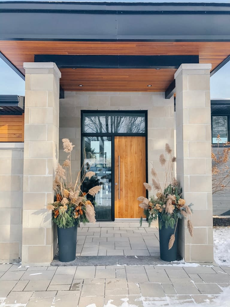 The stately entry with a magnificent wood door at the home of John and Joanne