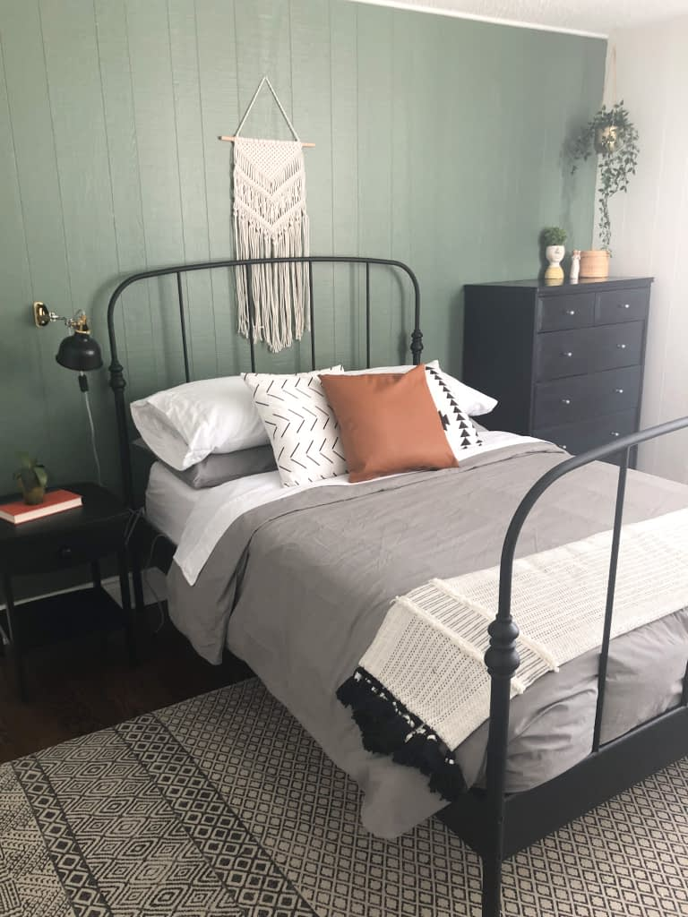 I am so pleased at how bright and inviting this updated room is even painted with a moody green and with lots of black.