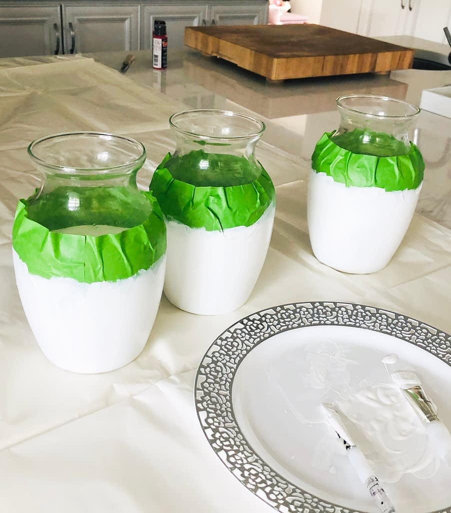 Painted glass vases taped