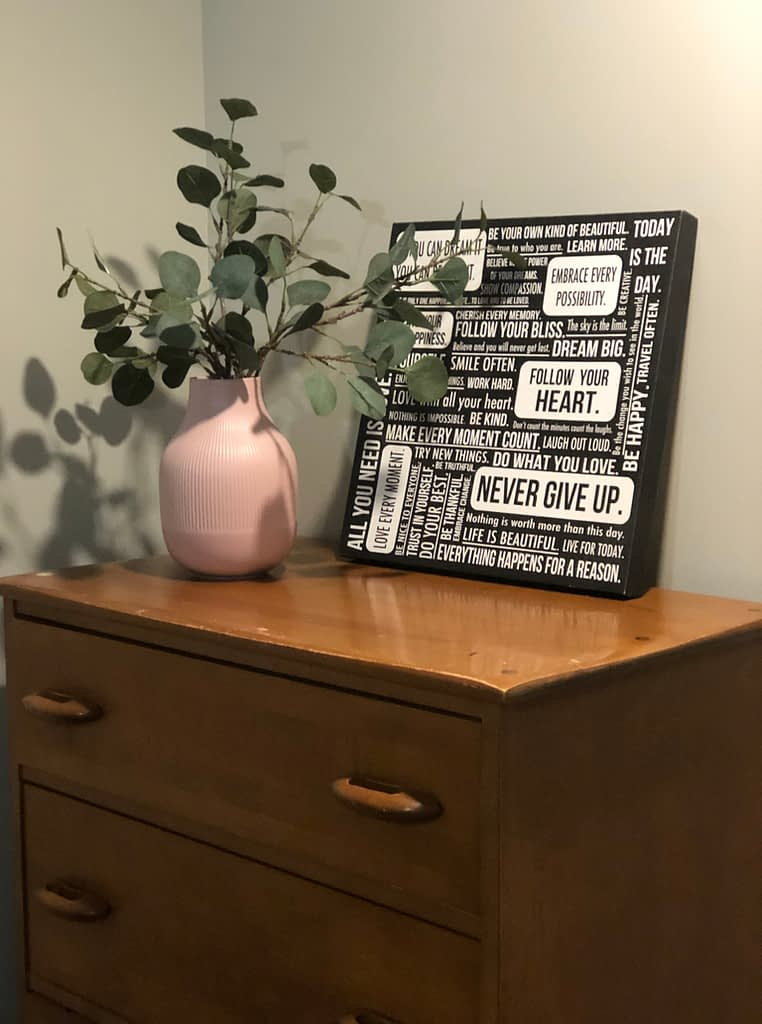 My childhood dresser gets a vase and some greens to update it.