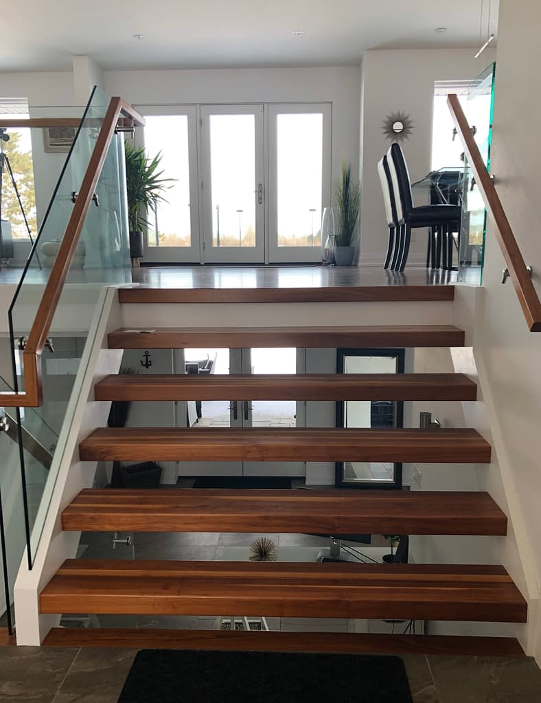 This stunning walnut staircase is the first thing you see when you enter the home but it gives you a taste of what is to come.