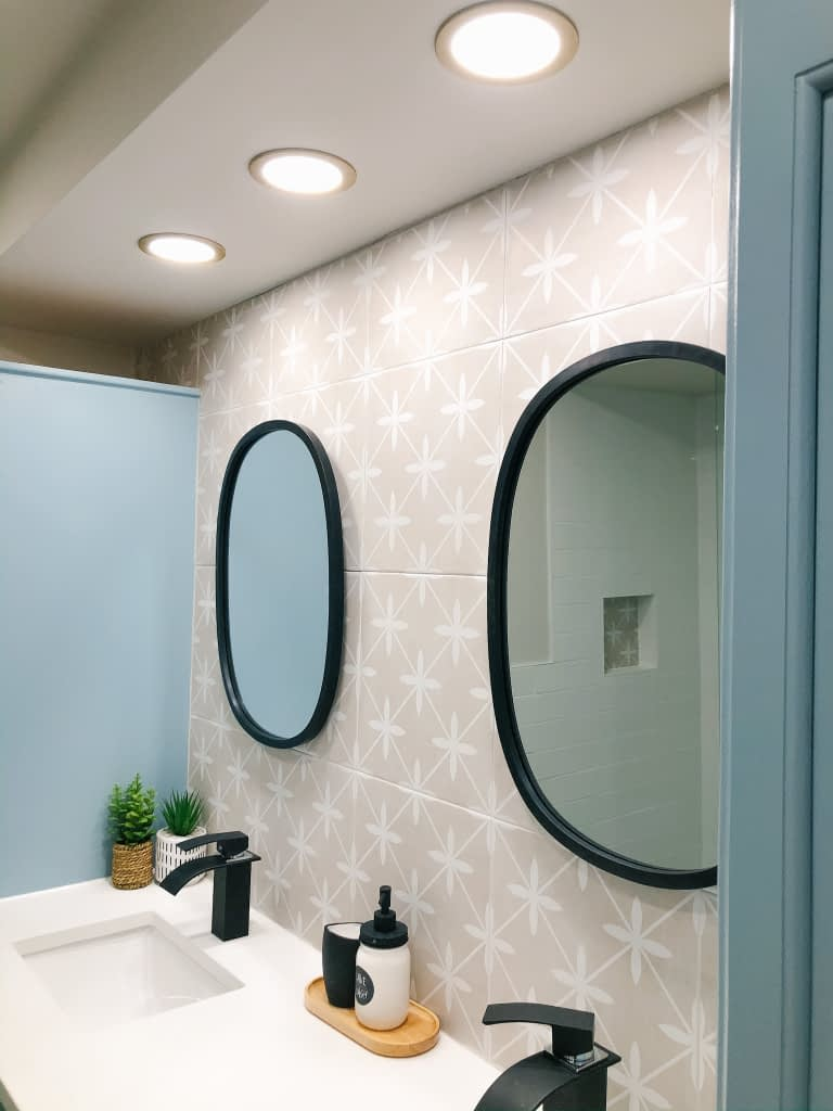 Pot lights turned out to be the best option for this bathroom with the bulkhead that we could not remove.