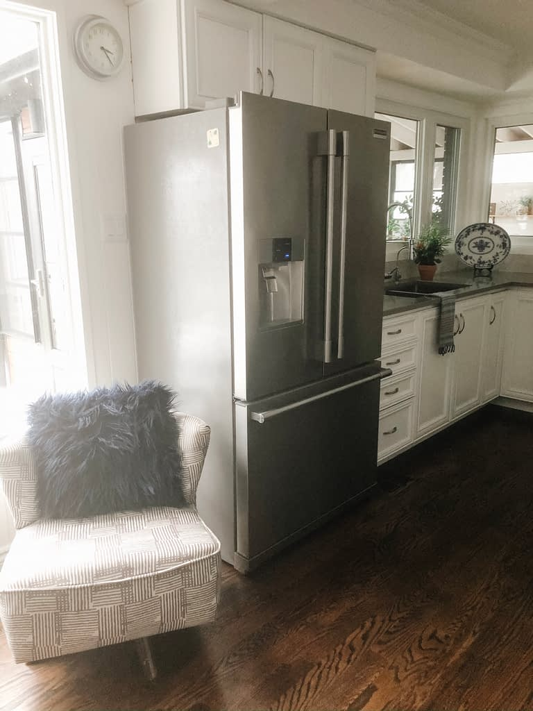 I really do not like the fridge in its current placement, but there is not much we could do without ripping everything out and starting the kitchen renovation from scratch.