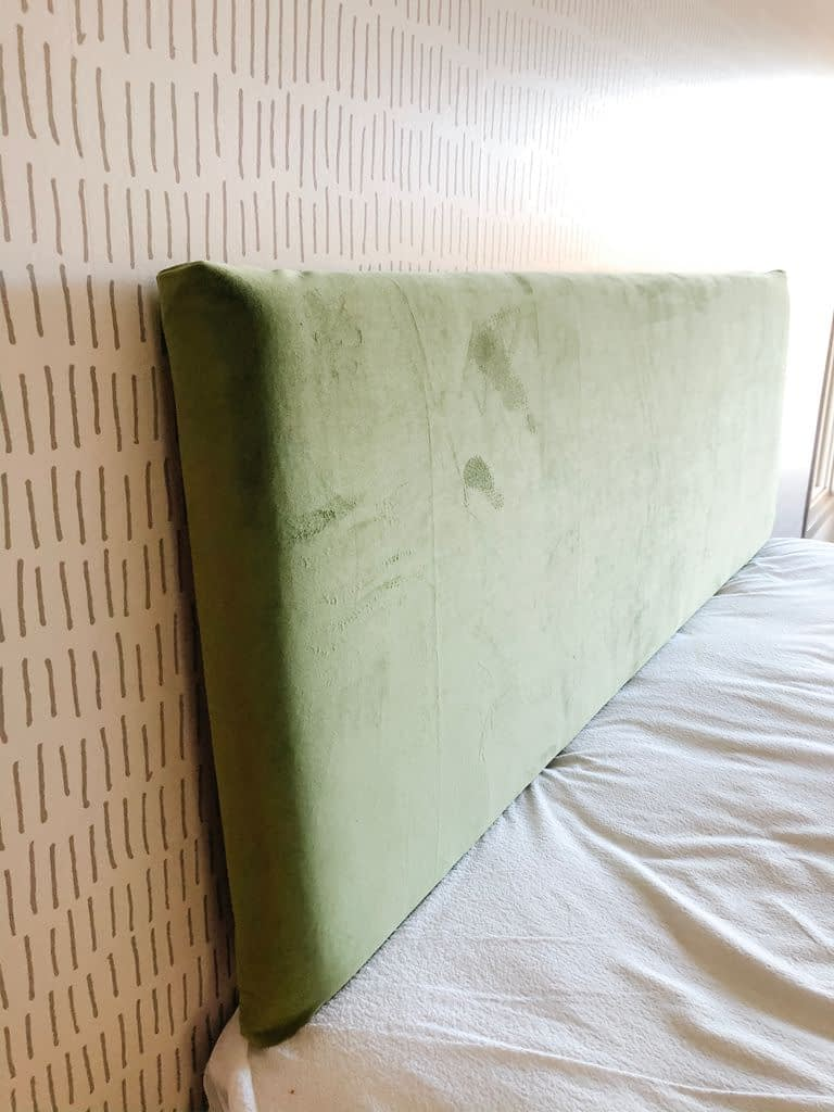 Here is the newly covered headboard before it was hung on the wall.