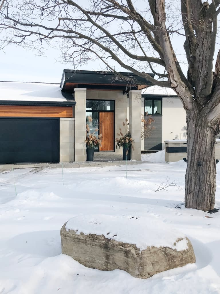 The combination of stone and siding allows the home to fit into its natural environment beautifully