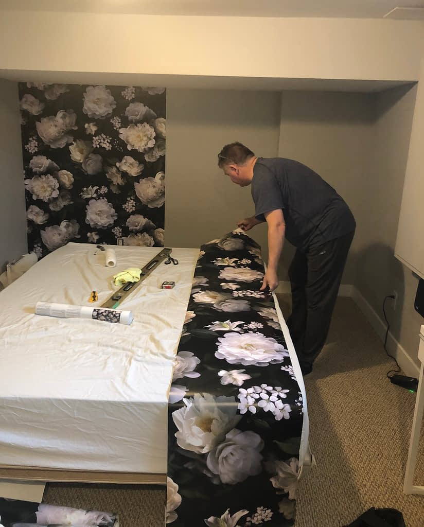 Ger is becoming an expert at wallpaper installation now.  It took no time at all to paper this 10 ft wall.