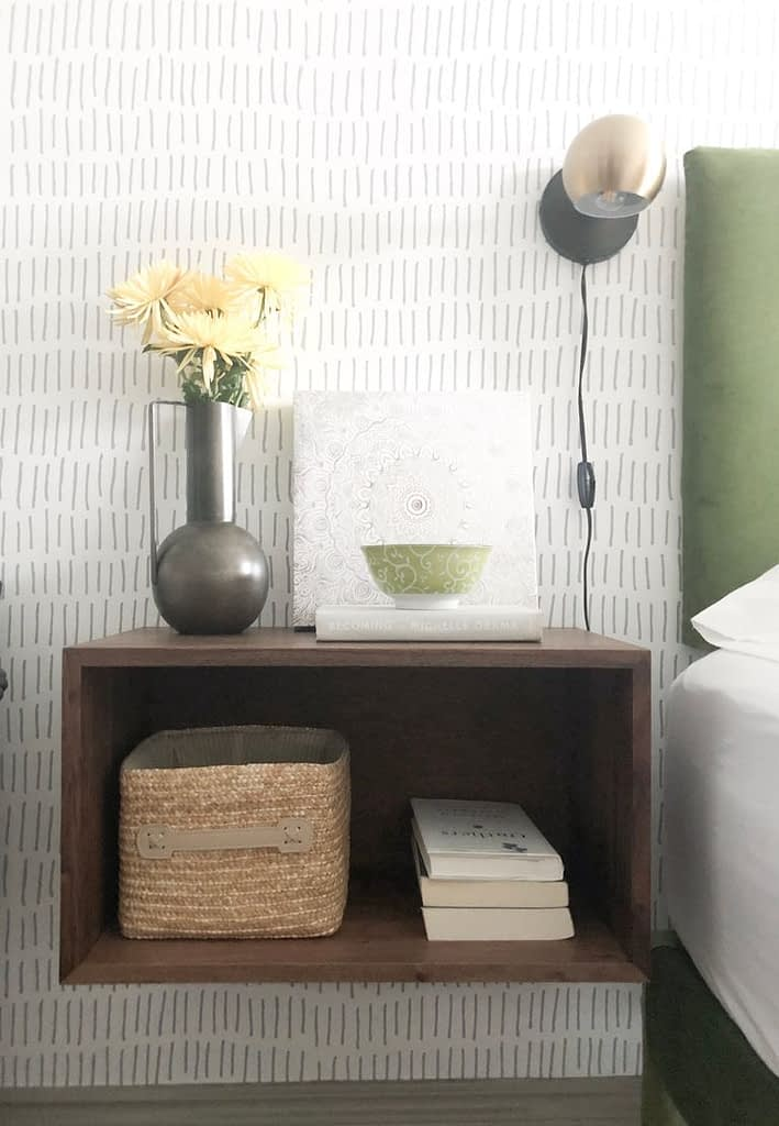 This nightstand from CB2 and the tick mark wallpaper from  @roommatesdecor I just love