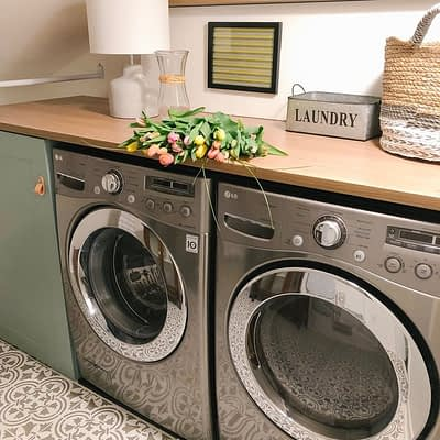 Functional Redesign Results in Bright and Cheery Laundry Room as Part of the ORC