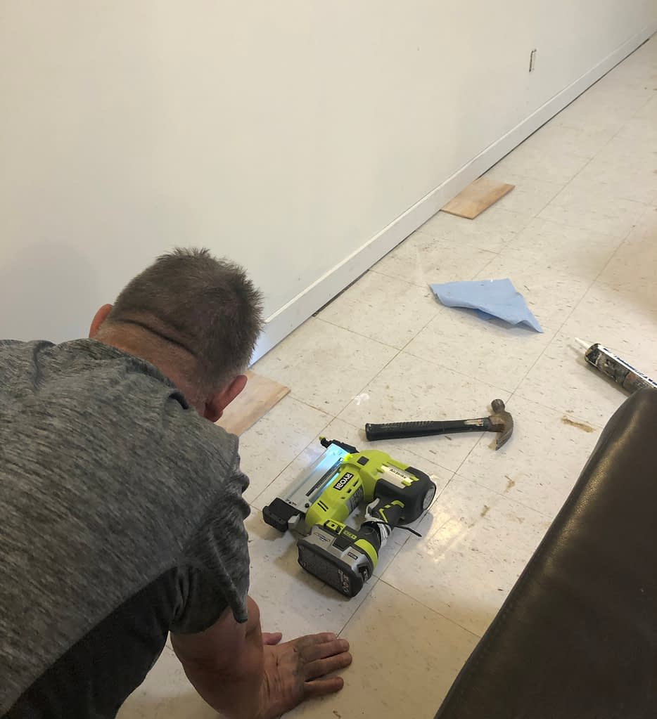 We got these baseboards in a package at Home Depot for a really good price.  They are smaller than I wanted but hubby is installing them 3/4 of an inch off the floor so the carpet tiles will slide under and they will look taller.